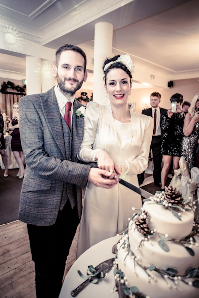 Winter wedding,  Vintage wedding, reception room, donington manor, bride and groom cutting cake, mark pugh photography