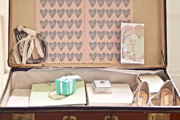Karen Massey Photography, suitcase of wedding details - favour box, shoes, stationery, horseshoe