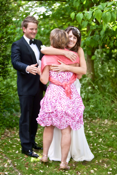 Karen Massey Photography, bride and groom, hugging friend