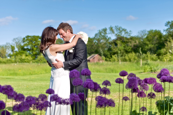 bride and groom in field, karen massey photography, purple flowers