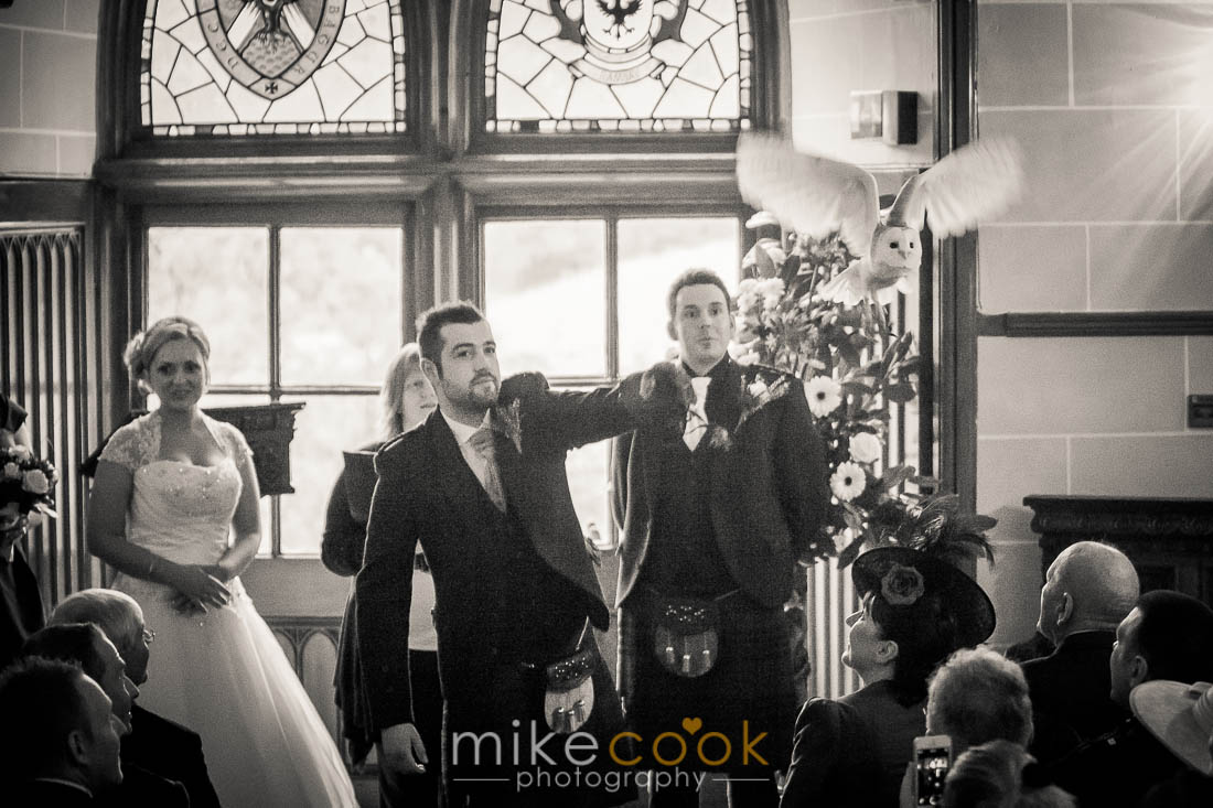 An elegant Dalhousie Castle Wedding with an Owl Ringbearer and a