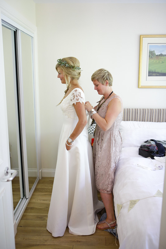 bride getting in dress, silver photography
