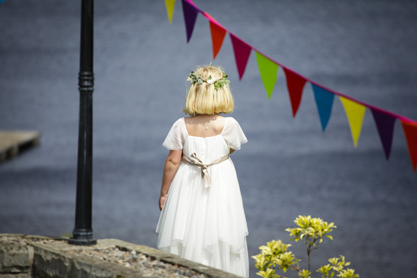 waiting flower girl, colourful bunting, silver photography