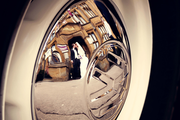 bride and groom reflection in wheel, adam watts photography