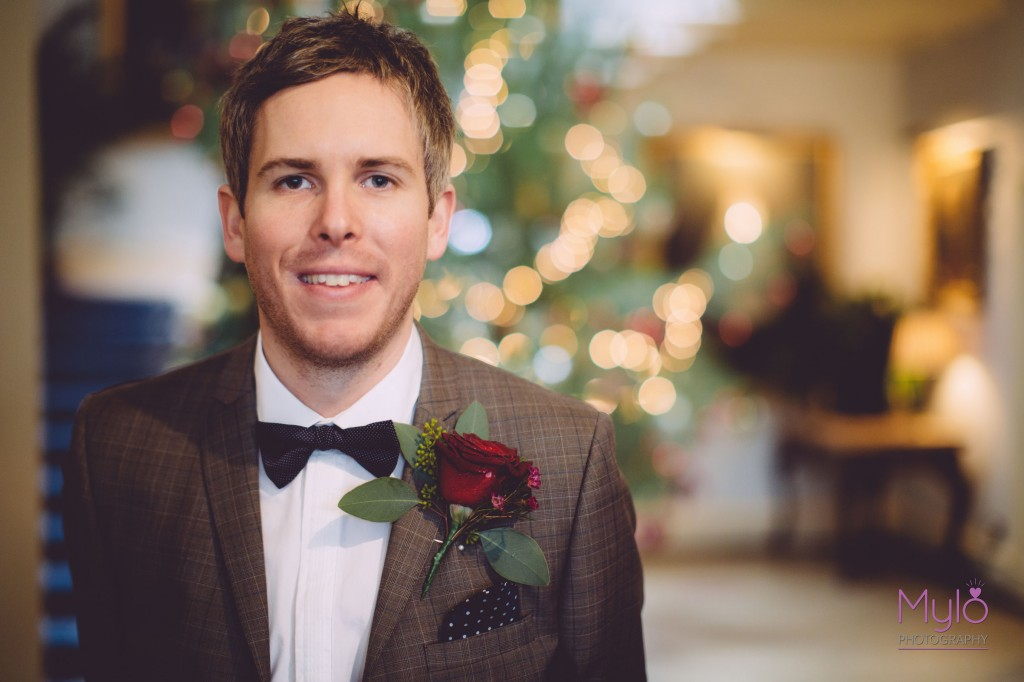 groom, ben sherman suit, red rose buttonhole, mylo photography