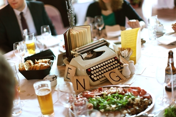 literary wedding centrepieces, typewriter, book, scrabble pieces , david perkins wedding photography