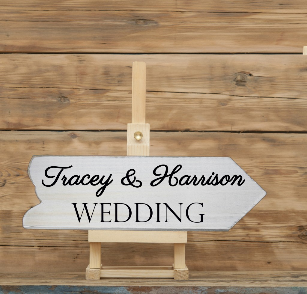 blank canvas on wooden easel againt wooden background, wedding sign well personalised