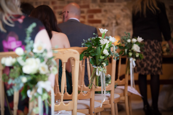 Upwaltham Barns Wedding | FitzGerald Photographic, pew end flowers