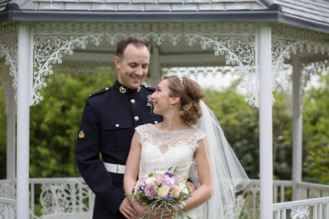 A pretty military wedding at Easter at the Great Tythe Barn with a ...