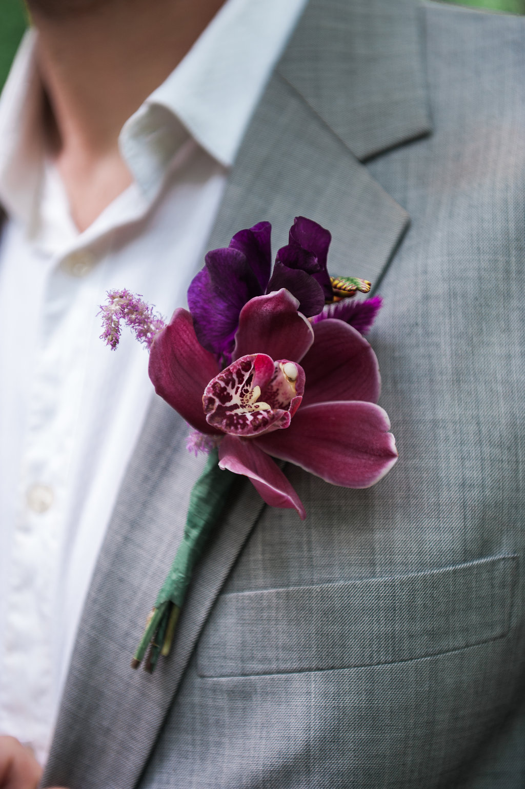 Dark Fairytale inspired Wedding - Wit Photography - Isle de L'Authie France - woods - grooms purple floral buttonhole