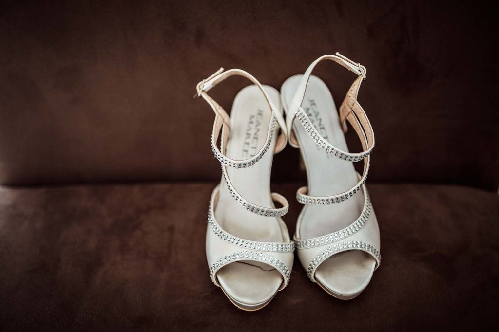 old hollywood inspired wedding - Clarte Photography white wedding shoes with silver detail