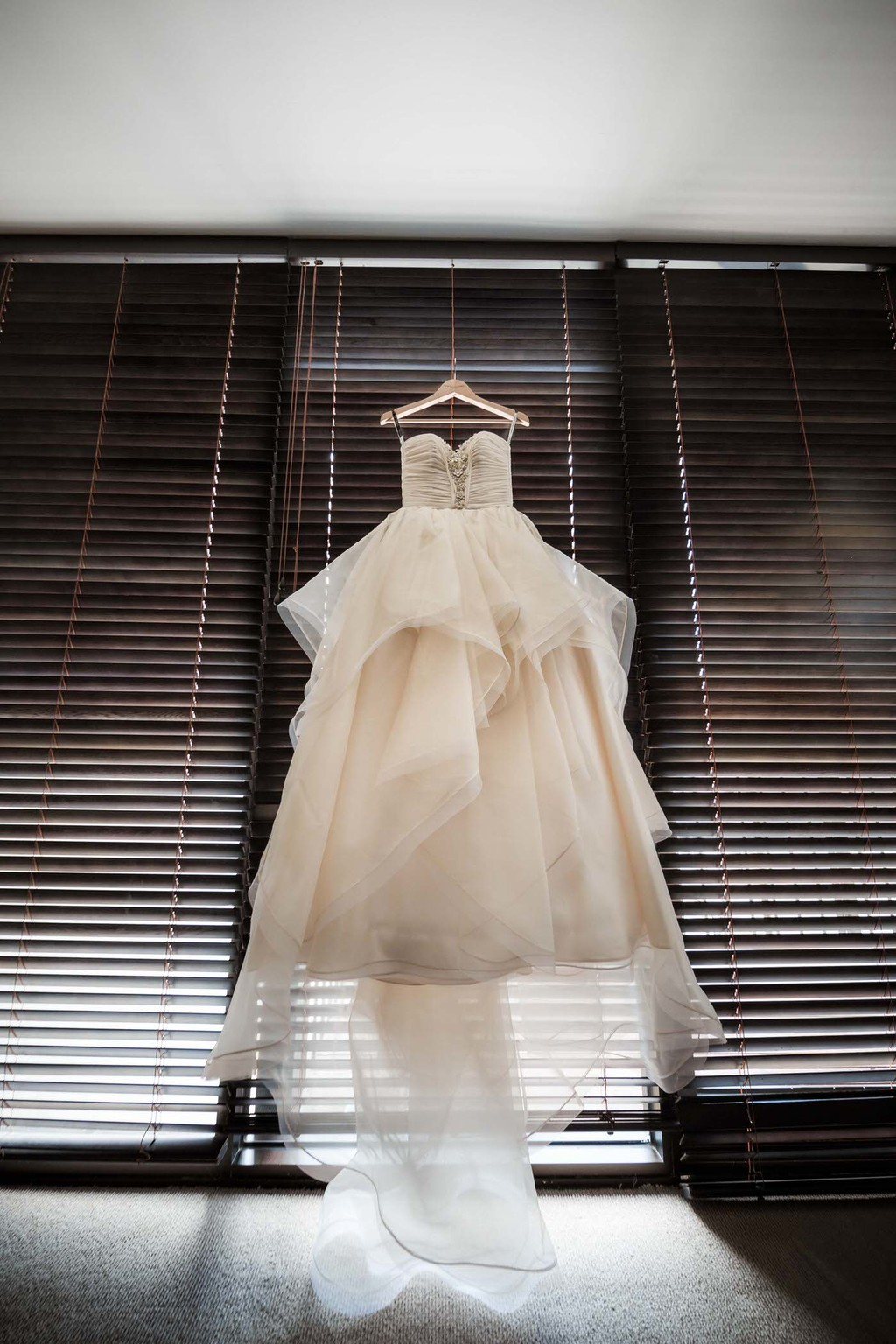 old hollywood inspired wedding - wedding dress hanging up